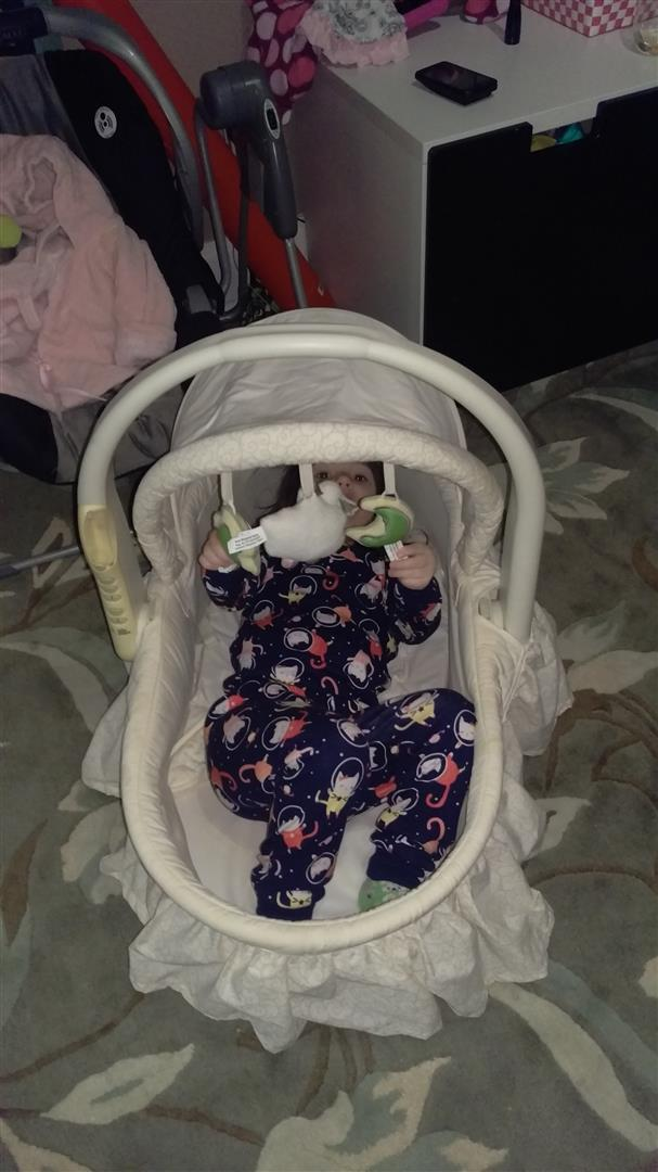 Maggie in the bassinet